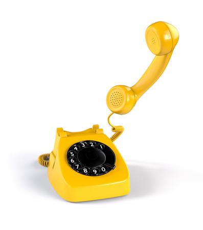 amarillo y negro: Amarillo rotatorio del teléfono en el fondo blanco Foto de archivo