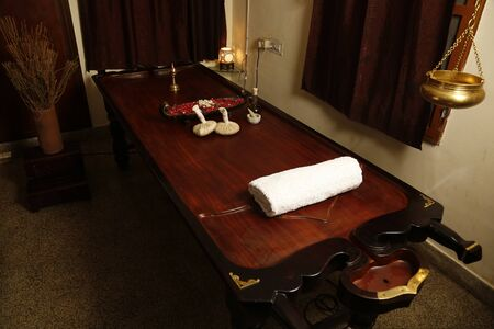 Ayurvedic massage therapy table made of authentic teak wood