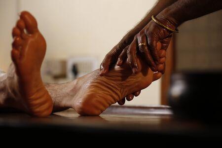 Ayurvedic feet massage Stock Photo