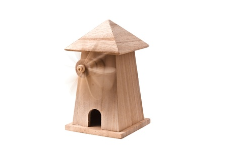 Wooden toy windmill with spinning wheel Imagens