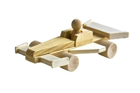 Wooden toy race car with driver on white background