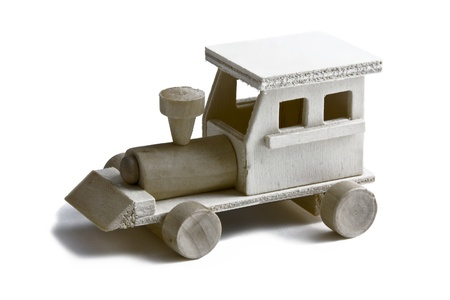 Wooden toy train with wheels on white background