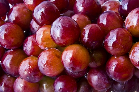 Background of red grapes with water droplets