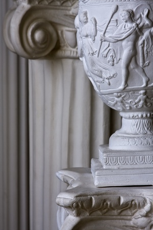 Detail of stone carving on lamp with columns on backgound and copy space