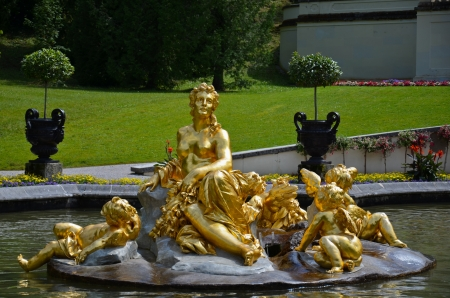 View of the main fountain in the park of the castle of Linderhof