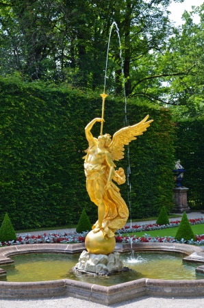 View of the fountain in the shape of an angel of the park in the castle of Linderhof
