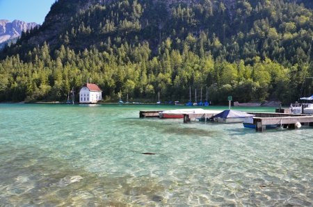 view of the mountain lake of Plansee Stock Photo