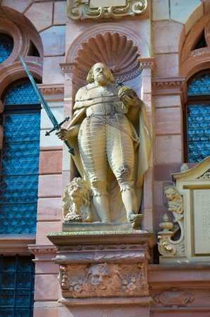 View of beautiful statue on the facade of the castle Editorial