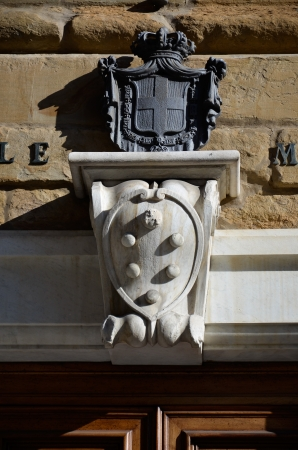 magnificent view of the Medici coat of arms at the entrance of the chapels