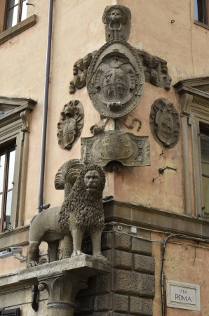 tuscia: Frieze on the wall of a building in the square of the plebiscite