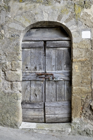 Quaint old door of a medieval village Stock Photo