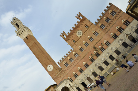 View on beautiful Town Hall and square of Campo in Siena