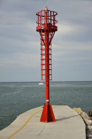 View of the imposing lighthouse at the entrance of the port channel Stock Photo