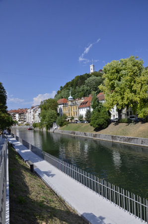 Picturesque view of the riverfront Ljubljanica and the tower of the castle Stock Photo