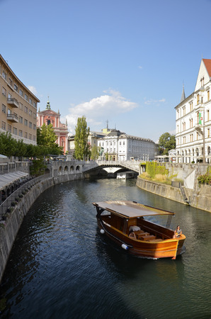 Characteristic glimpse of the beautiful center of the Slovenian capital across the river Ljubljanica