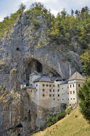 Characteristic and imposing Predjama Castle, perched on a mountainside