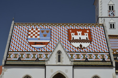 Characteristic colorful tiled roof of the Cathedral of San Marco Stock Photo