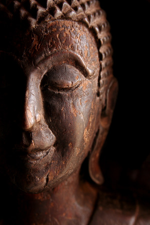 Wooden buddha statues close up