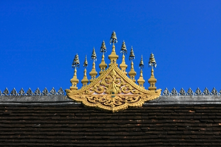 the world heritage: Gable apex on the roof of temple in UNESCO world heritage town, Laos Stock Photo