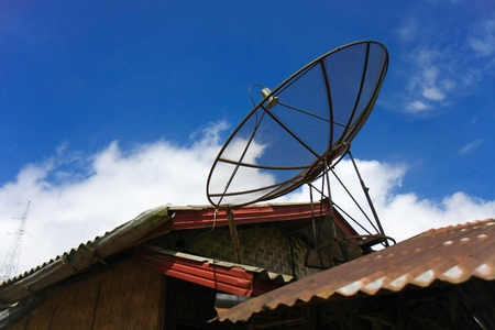 Satellite dish with sky on roof of traditional thai house Imagens