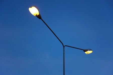 Streetlight isolated on beautiful blue sky Imagens