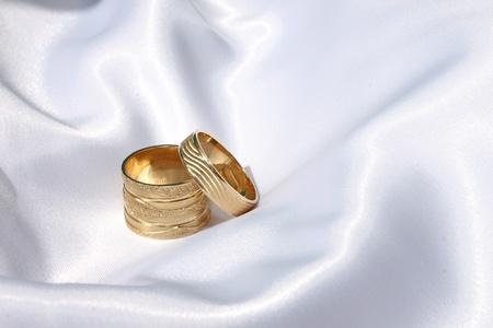 wedding rings on the satin/silk surface Stock Photo - 9060518