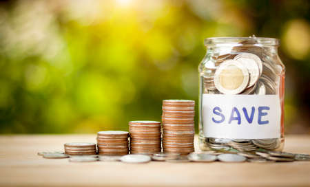 Coins in a jar to show saving money, investment and business with money coins stack for growing with natural Banque d'images