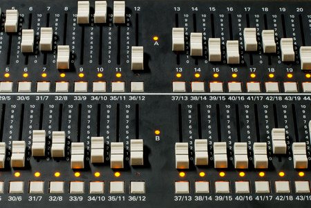 adjuster: Close Up on a slide of a mixing console. It is used to control the Lighting for recording TV shows