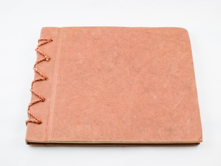 Brown notebook on a white background photo