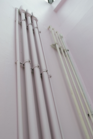 conduit: Installation of electrical conduit to a wall in the building