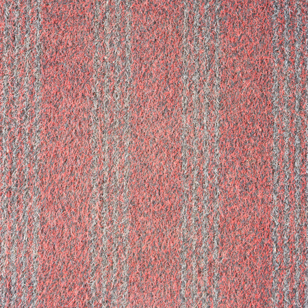 rug texture: Vertical striped red carpet surfaces. Stock Photo