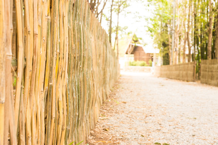 Bamboo fence with scaled stone road to home Stock fotó