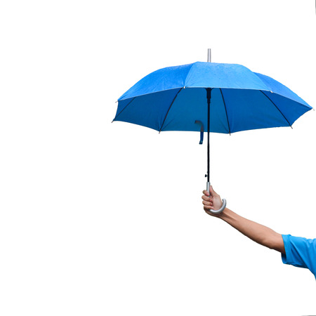 A man's hand holding blue umbrella while rainning