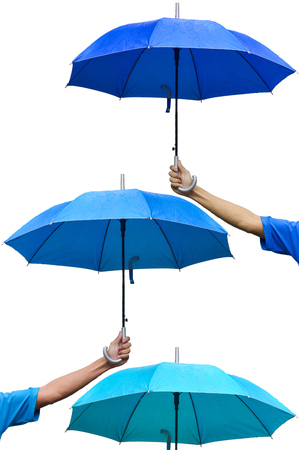 gents: Hand holding umbrella to protect rain 3 Steps, Protection Concepts, Umbrella third floor, The umbrellas over umbrella, different color. Stock Photo