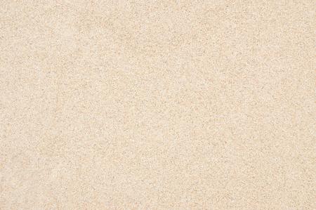 여름에 해변 모래 질감의 근접 촬영. 좋은 모래 질감. 아름 다운 모래 배경입니다. 밝은 빛에 바다에서 갈색 모래입니다. 모래에서 배경 이미지입니다.