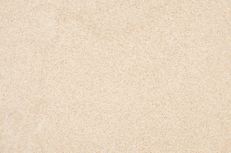 closeup of beach sand texture in the summer. fine sand texture. beautiful sand background. brown sand at sea in bright light. Background image from sand. picture shoot in holiday. photograph at top view.