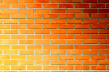 Blurred image of bi-color brick wall