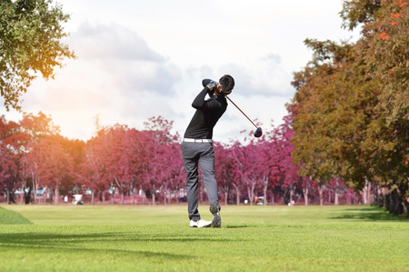 Golfers hit sweeping golf course in the Autumn Foto de archivo