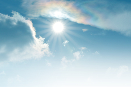 Sunlight with clouds and blue sky and rainbow