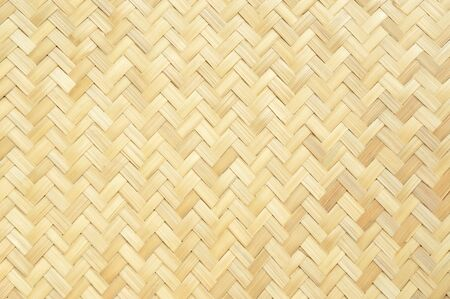 Traditional handcraft weave Thai style pattern nature background texture wicker surface for furniture material Standard-Bild
