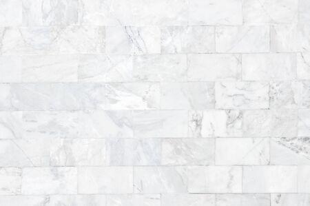 Weißes Marmorwandmuster mit hoher Auflösung. Ziegelmauer aus Marmor als Textur und Hintergrund. Standard-Bild