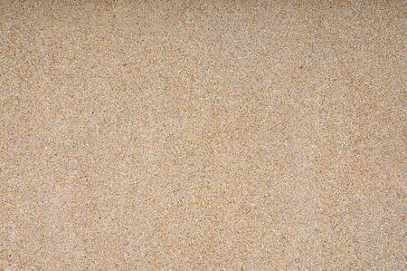 Texture et fond de sable lavé. Mur en mélange de lavage de sable fin et grossier avec mortier de ciment.