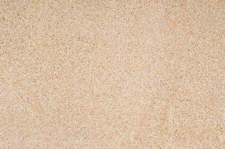 Texture et fond de sable lavé. Mur en mélange de lavage de sable fin et grossier avec mortier de ciment. Fond de clôture de mur de pierre.