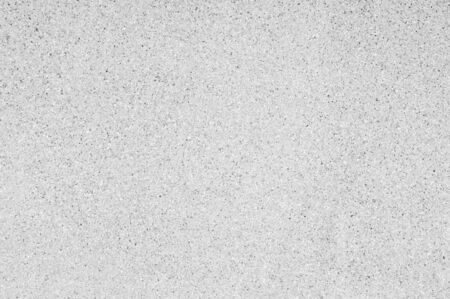 Washed sand texture and background. Wall made from fine and coarse sand washing mix with cement mortar. Stone wall fence background.