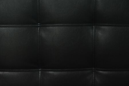 Black leather texture background with square buttoned pattern 스톡 콘텐츠