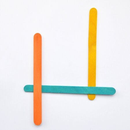 J, The English alphabet from wood sticks, isolated on white background.