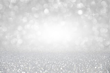 Abstract silver glitter christmas background with light bokeh
