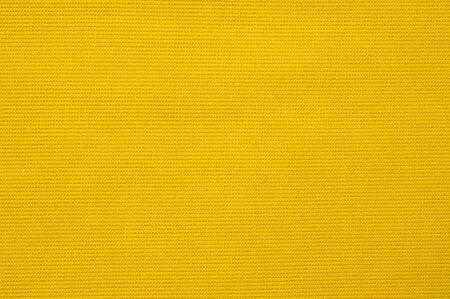 Textura de tela amarilla para el fondo