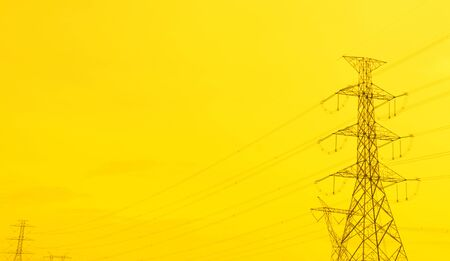 A high voltage post with golden sky. Prosperity to the city. Public utility or infrastructure. 스톡 콘텐츠