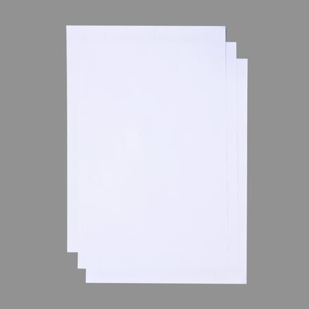 Three paper sheets isolated on gray background, Mounted in the wall or offices. Stock Photo